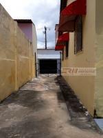 Roque Macatrão: Garagem / Lateral